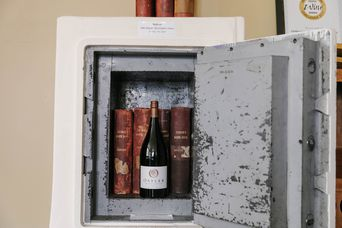 Close up of wine and a couple of books kept in a safe.