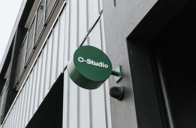 O-Studio signage on the exterior of the building.