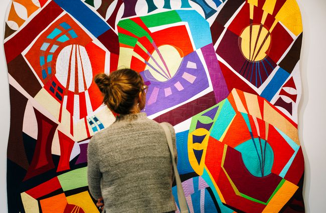Woman enjoying colourful art work.