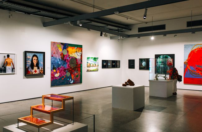 White gallery walls with vibrant art.