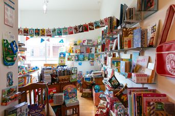 Colourful books hanging up inside.