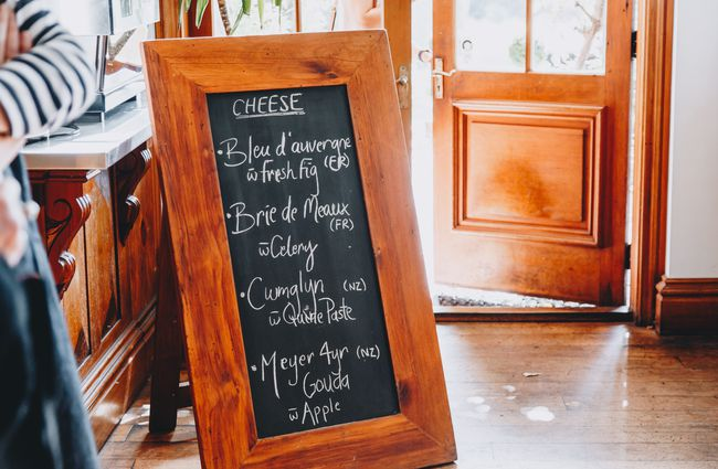 A chalkboard menu on the floor at Pegasus Bay winery and restaurant in North Canterbury.