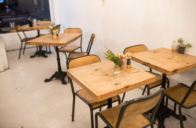 Wooden tables inside seating.