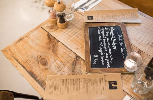 Blackboard menu on the wooden table.