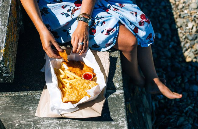 Woman eating fish and chips.