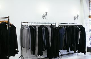 Clothes hanging on racks.