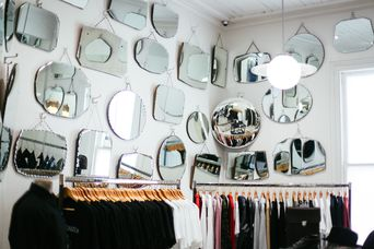 Mirrors hanging on walls.