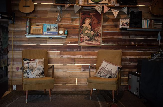 Wooden walls with couch seating.