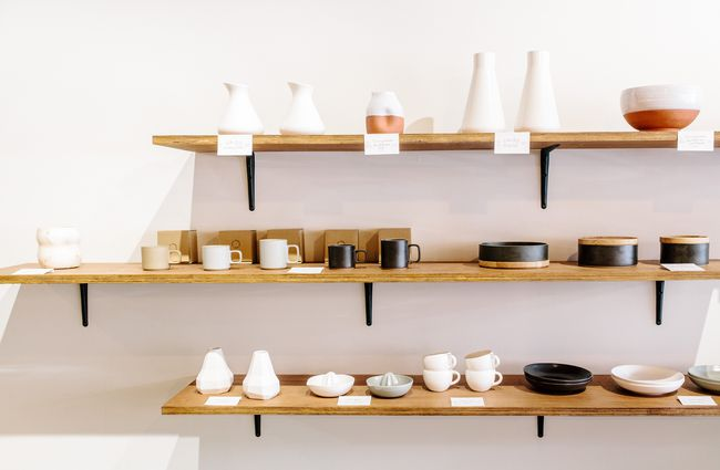 Ceramics on display on shelves.