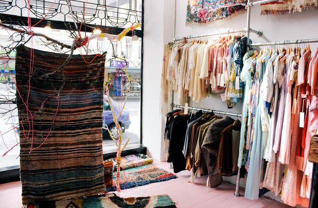 Clothes and a rug hanging up.