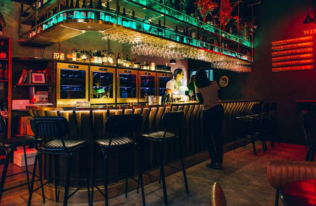 Long bar with colourful mood lighting.