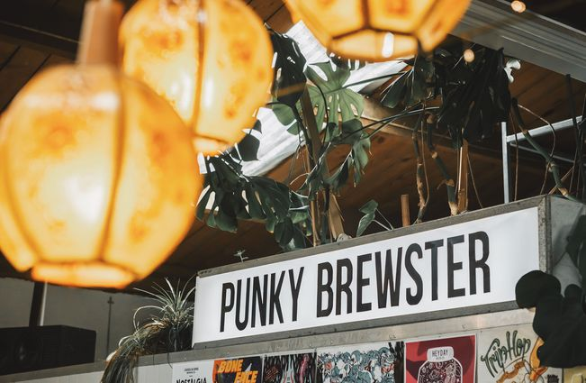 Punky Brewster sign and yellow glass lamps.