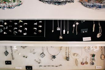 Jewellery in display cabinets.