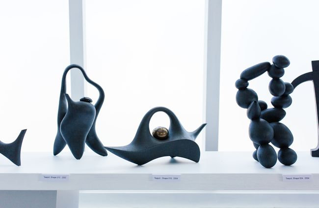 Black ceramics displayed on a table.