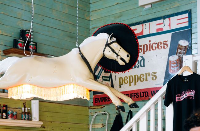 A horse lamp hanging from the ceiling at Queen Sally's Diamond Deli and cafe Wellington.