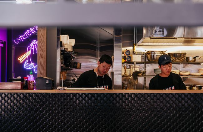 Chefs working in a ramen kitchen.