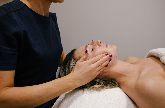 Woman receiving a facial.