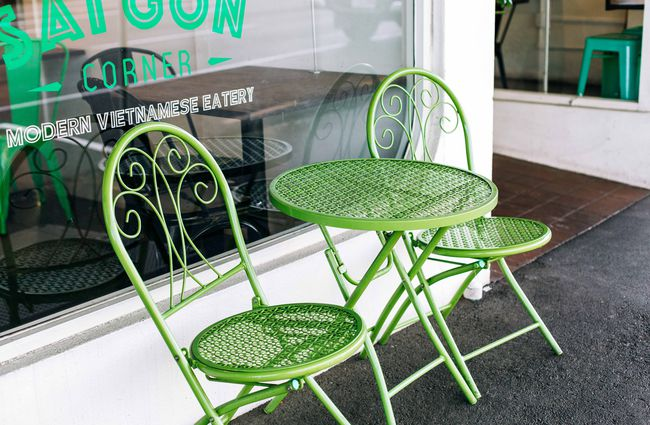 Close up of green outdoor chairs.