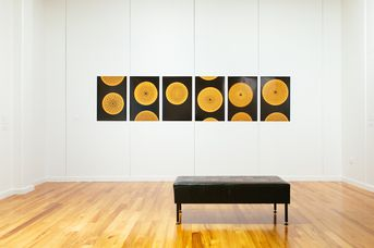Black and yellow circle artwork on the wall.