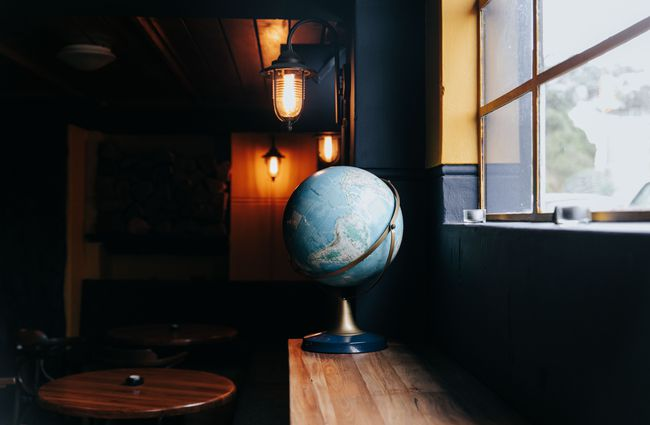 A globe on a counter inside the bar.