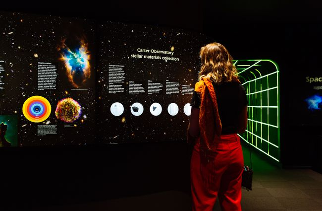 A woman looking at a display inside Space Place Wellington New Zealand.