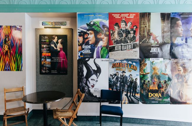 Close up of movie posters on a wall.