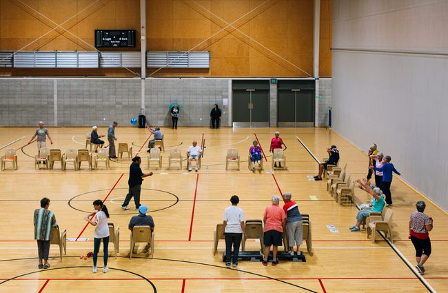 Courts with people playing a game.