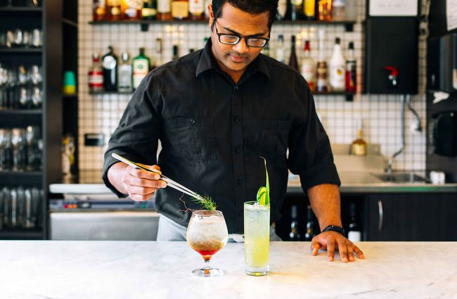 A man preparing cocktails.