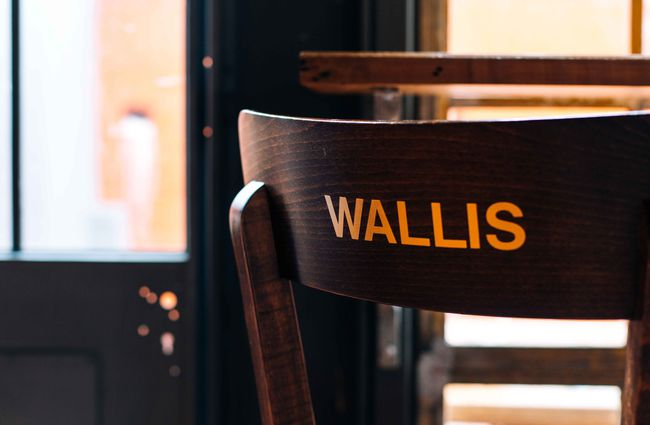 Wooden chair with Wallis written on it in gold.