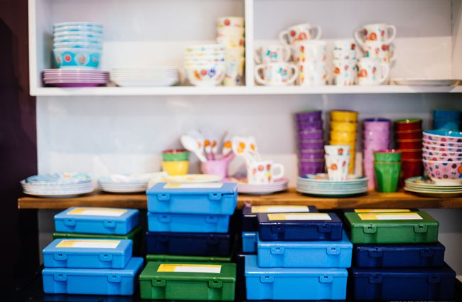 Close up of colourful lunch boxes.