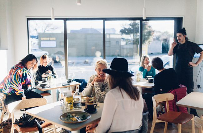 Busy interior filled with customers at The Birdwood, Christchurch.