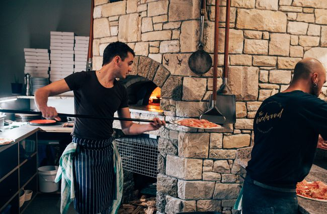 Chef prepares pizza at The Birdwood, Christchurch.