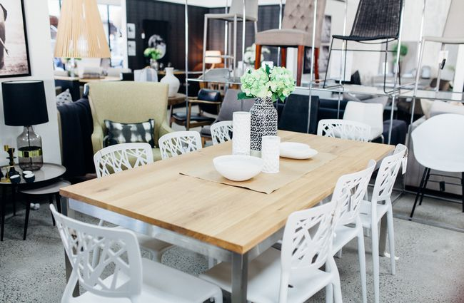 White chairs and wooden dining table.