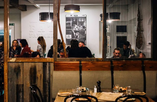 People dining inside the Fat Farmer restaurant.