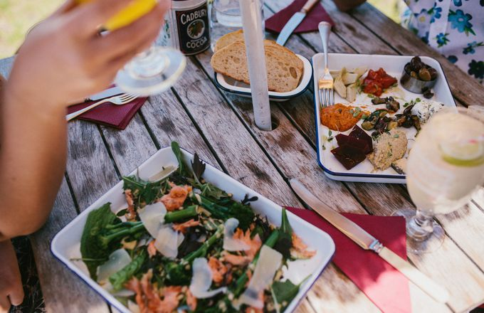 A table of food on an outside table.
