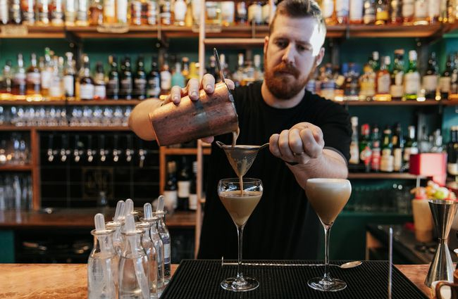 Close up of the barman making a cocktail.