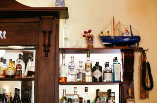 Close up of liquor behind the bar.
