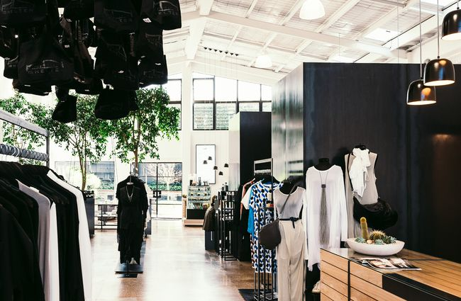 Interior of store with black and white clothing.