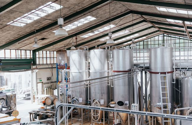 View of the brewery floor and brewing tanks.