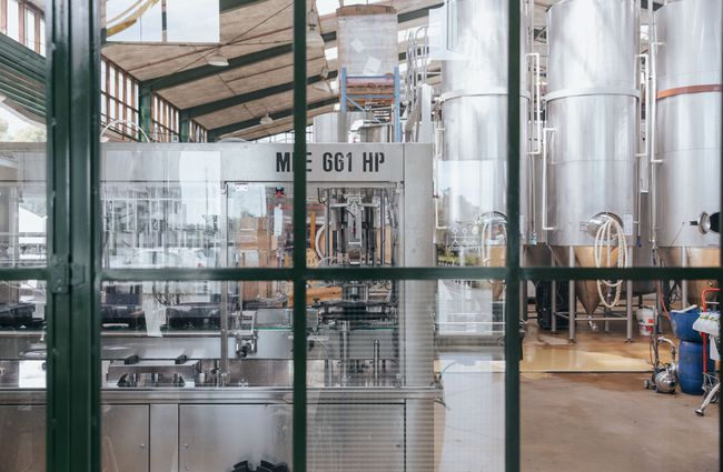 View through the window to the brewery floor.