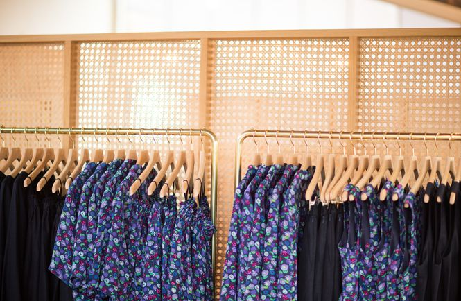 Close up of clothes on a rack.