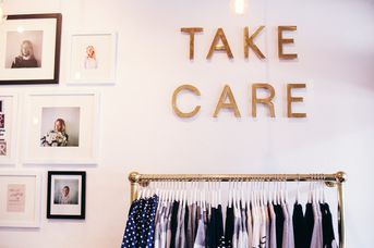 Take care sign on wall.