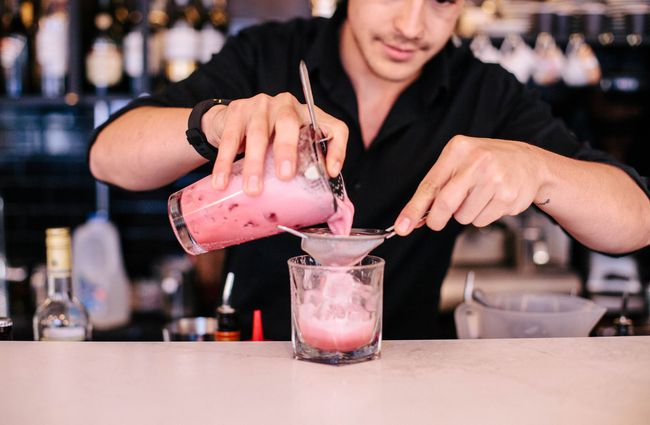 A staff member making a cocktail.