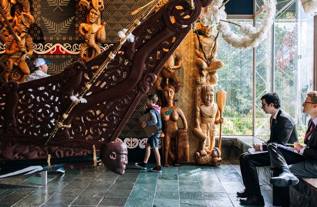 Visitors taking in the waka at Waikato Museum, Hamilton.