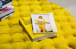 Yellow books on a yellow seat inside Wanda Harland Wakefield Street store in Wellington, New Zealand.