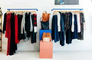 Womenswear on display on racks inside Wanda Harland Wakefield Street store in Wellington, New Zealand.