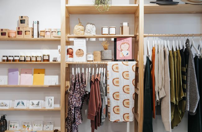 Clothes and homewares on shelves.
