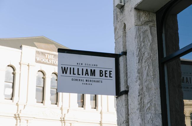 Exterior sign for William Bee store.