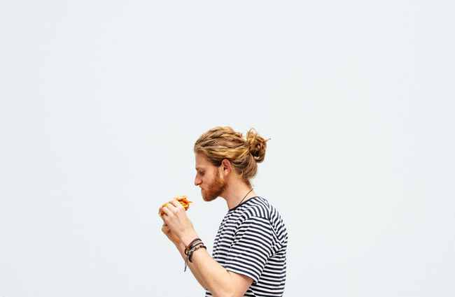 A man eating a burger.