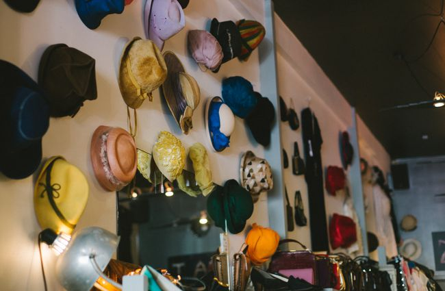 Hats on a wall.